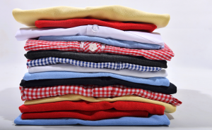 School uniform folded up and laid on top of each other in a pile